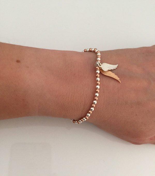 angel wing beaded stretch bracelet 5e4575fc scaled