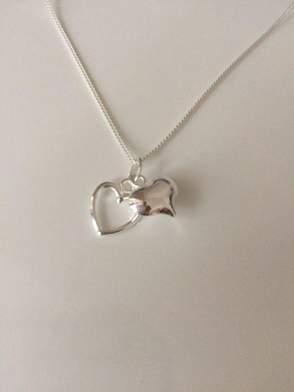 silver heart necklace 5e4571ea scaled