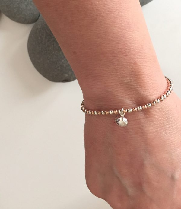 sterling silver and rose gold clam shell bracelet 5e459882