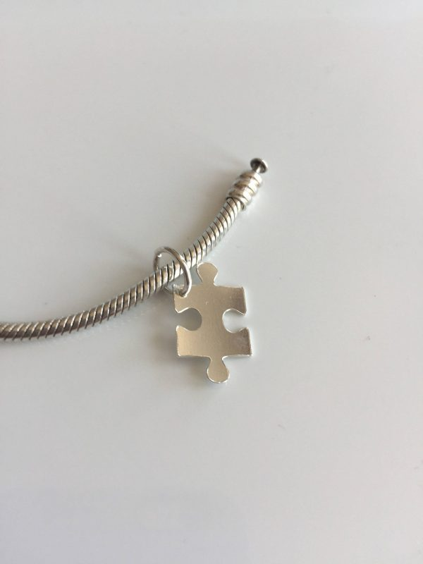 sterling silver jigsaw puzzle piece charm 5e4594b3 scaled